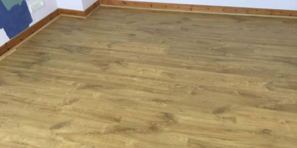 bedroom fitted out with new laminate flooring in a house at Wantage